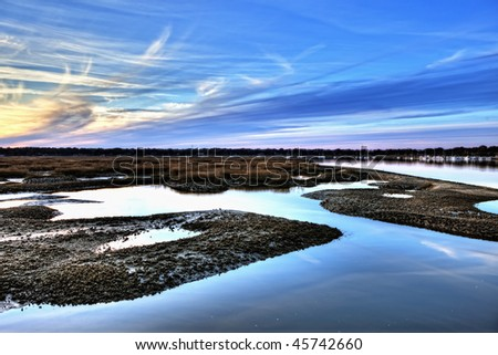 hdr image of oyster beds and harbor at sunset - stock photo