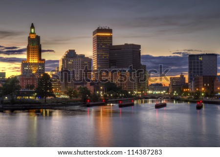 HDR image of the skyline of Providence, Rhode Island from the far side of the Providence River viewed just as the sun is setting at dusk - stock photo