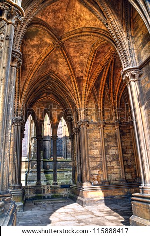 HDR image showcases the Gothic architectural details of a vaulted ceiling in Lincoln Cathedral, england. - stock photo