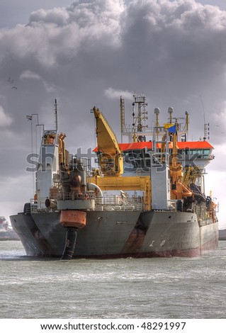 HDR of Dredger Oranje full front in port - stock photo