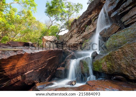 HDR photo of mountain river and small waterfall - stock photo