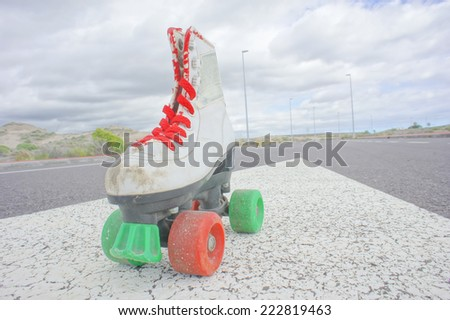 Hdr Picture of Old Vintage White Skate Boot on the Asphalt Sterret - stock photo
