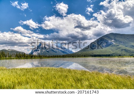 HDR rendering of Vermilion Lakes in the Summer at Banff National Park, with Mt Rundle in the background. - stock photo
