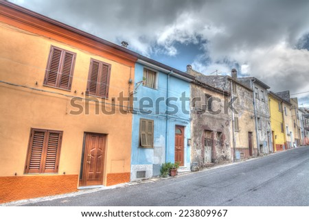 hdr street  under a cloudy sky - stock photo