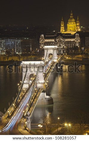 HDR View of Chain Bridge and St. Stephen's Basilica at night.Budapest, Hungary - stock photo