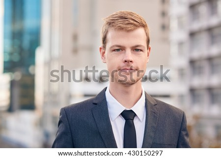 He's a young and confident businessman - stock photo