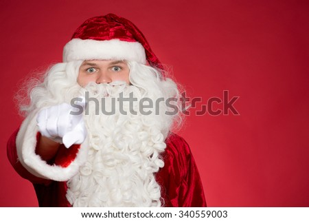 He chose you. Saint Nick pointing at the camera with his finger with his eyes wide open  - stock photo