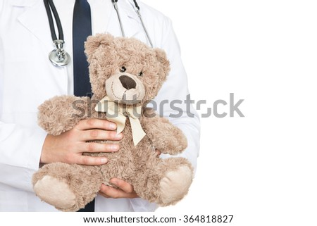 He is worth your trust. Cropped shot of a male doctor holding a teddy bear - stock photo