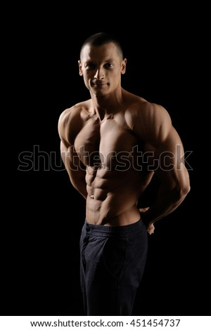 He knows how to push his limits. Vertical shot portrait of a shirtless fitness man showing off his strong muscular body looking to the camera - stock photo