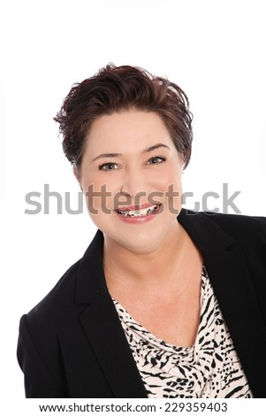 Head and Shoulders Close Up Portrait of Smiling Woman with Short Dark Hair in Studio - stock photo