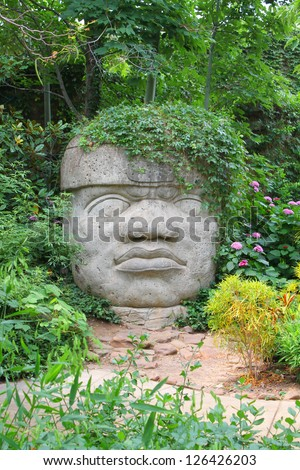 Head carved from stone - stock photo