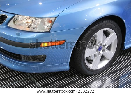 Head lamp of blue saab car - stock photo