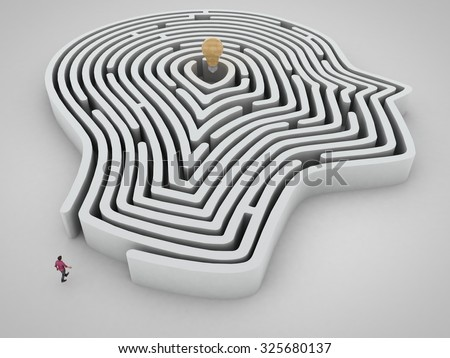 Head maze with man and light bulb as a goal - stock photo
