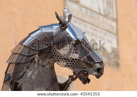 Head of an horse of an iron statue in the historic city of Briancon, France - stock photo