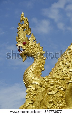 Head of naka statue wth blue sky in Nakoen Phanom temple Thailand - stock photo