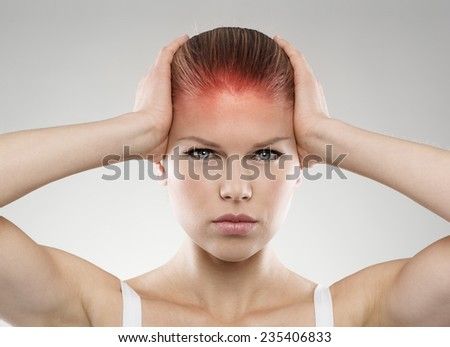 Head pain or injury. Young stressed female suffering from dizziness or tension. Medical treatment and health care concept.  - stock photo