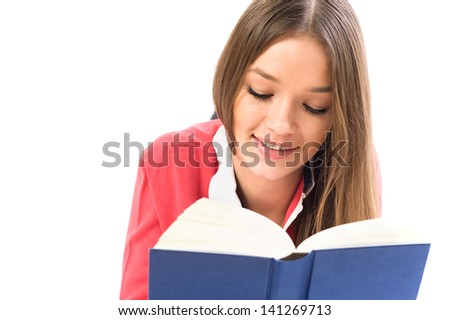 Head portrait of young beauty woman reading the book - stock photo