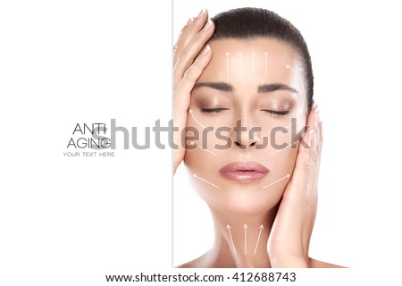 Head shot of beautiful model with hands on face and closed eyes with a serene expression suitable for anti aging treatment and plastic surgery concept. Isolated on white with copy space for text. - stock photo