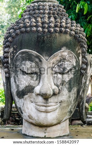 Head shot of buddha statue, Thailand. - stock photo