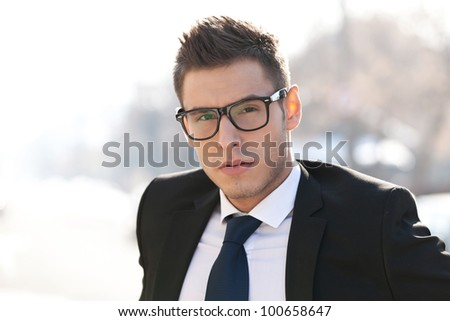 Head shot of executive wearing glasses - outdoor picture - stock photo