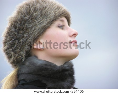 Head shot of girl with fur hat and choker - stock photo
