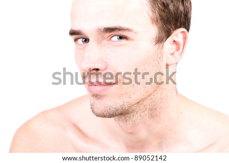 head-shot of smiling man, portrait - young handsome male model, attractive  and seductively looking - made in studio on white background - stock photo