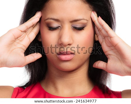 Headache, migraine and sinus ache. Stressed young woman worried girl mixed race suffering from head pain closed eyes isolated on white - stock photo