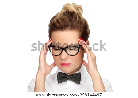 Headache migraine people. Stylish woman suffering from stress or a headache grimacing in pain, isolated. - stock photo