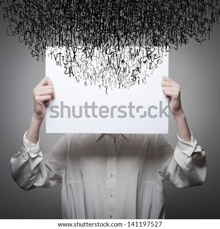 Headache. Obsession. The stream of dark thoughts. Expressions, feelings and moods. Young woman suffering from dark thoughts. Young woman hiding her face with a white paper. - stock photo