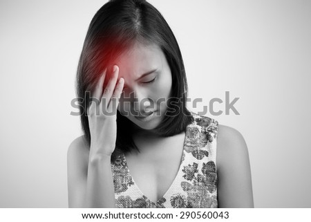 Headache. Young asian woman having a headache - stock photo
