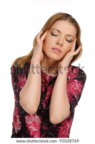 Headache - Young woman holding head in pain over white background - stock photo