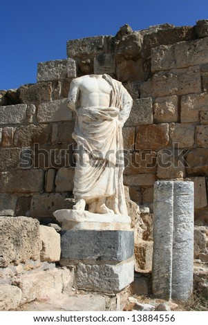 Headless sculpture of an ancient god on the ruins of town Salamis, Northern Cyprus - stock photo