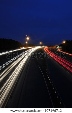 Headlight and taillight trails of highway traffic in Raleigh, North Carolina - stock photo