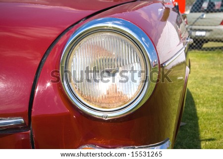 headlight in vintage european red car front - stock photo