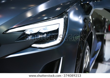 headlight of new automobile - stock photo