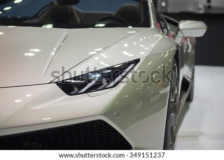 Headlight of the bronze car - stock photo