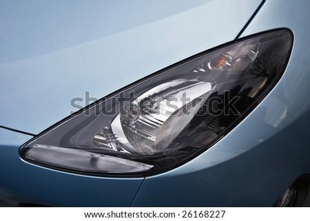 Headlight of the modern car - stock photo
