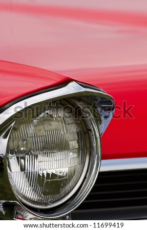 Headlight on a American car from the fifties - stock photo