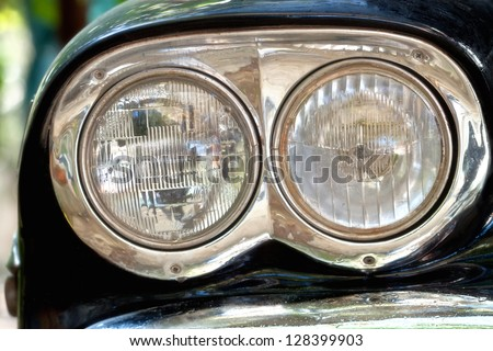 Headlight on a Black American Car - stock photo