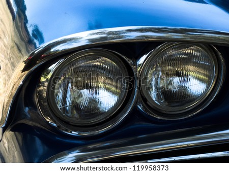 Headlights of a classic american car headlights - stock photo