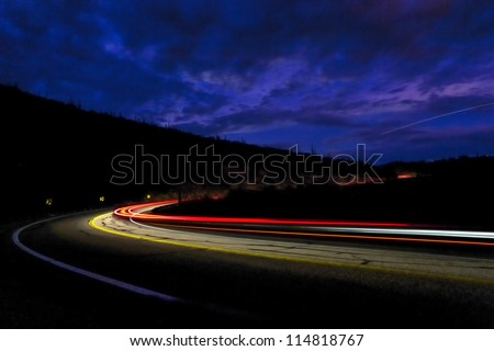 headlights of car in the mountains of Arizona - stock photo