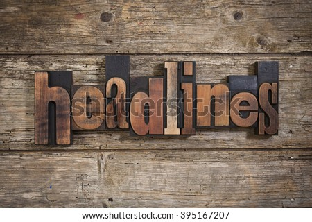 headlines, single word set with vintage letterpress printing blocks on rustic wooden background - stock photo