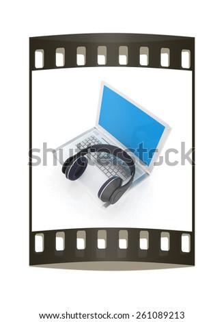 Headphone and Laptop. The film strip - stock photo