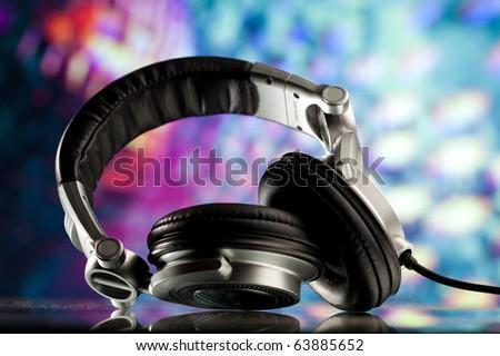 headphones against disco background - stock photo