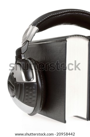 headphones and book (audio book concept) - stock photo