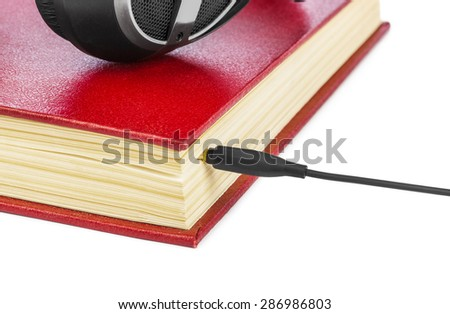 Headphones and book isolated on white background - stock photo