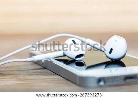 headphones and phone depth of field - stock photo
