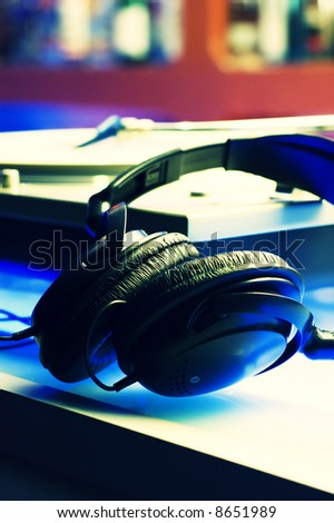 Headphones and turntable with cross-process color effect. - stock photo