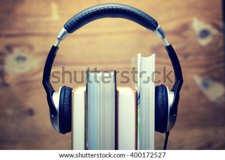 headphones Audiobook concept - stock photo