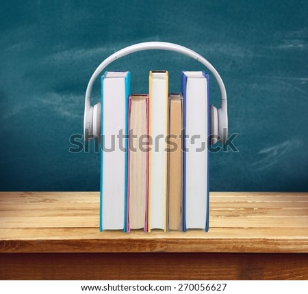 Headphones, Book, Listening. - stock photo